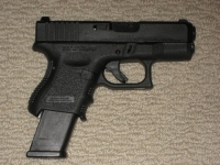 Baby Glock with High Cap Magazine