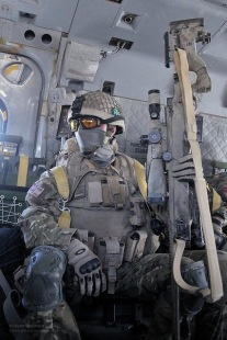 Sniper riding in helicopter