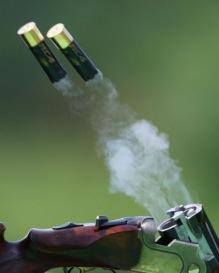 double barrel shotgun ejecting
