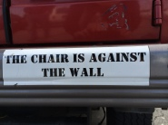 the chair is against the wall