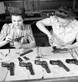 women cleaning browning high power pistols