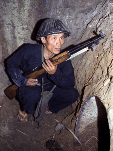 vietnam-war-a-viet-cong-soldier-crouches-in-a-bunker-with-an-sks-rifle-late-1960s