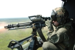 Firing M134-D Minigun From USMC UH1