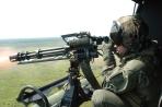 Firing M134-D Minigun From USMC UH1